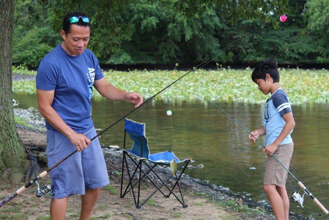 Kenny Fernandez and his son Kian fish at Wyoming Park Aug. 7.