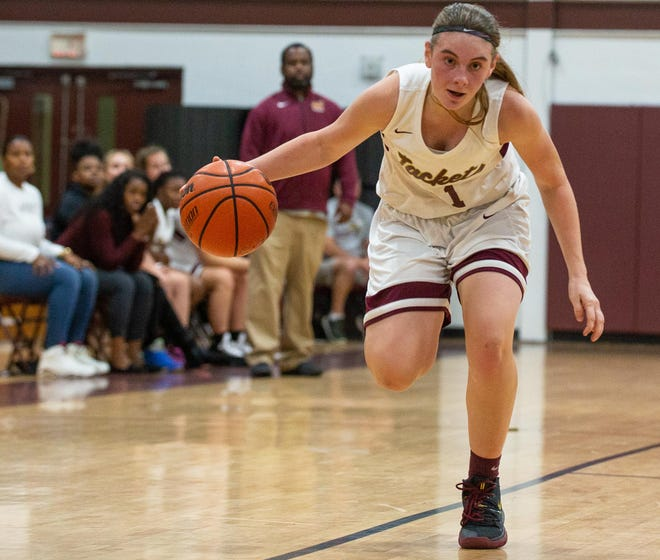 St. Augustine guard Kyra Stauble dribbles up the court. The Yellow Jackets are among dozens of Northeast Florida teams in action for the start of girls basketball district tournaments.