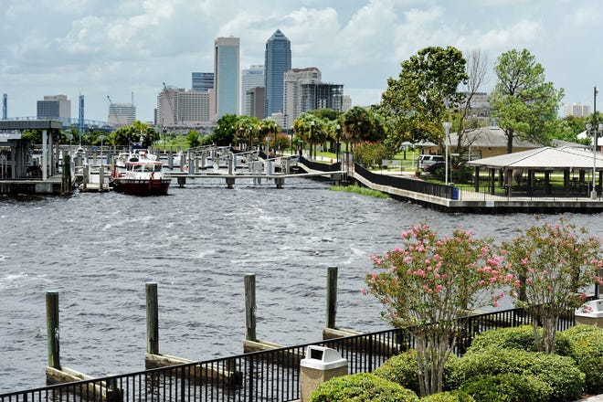Downtown skyscrapers rise in the distance from Metropolitan Park. [Bob Self/Florida Times-Union]