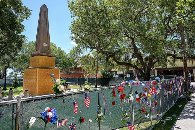 Temporary fencing surrounds the Confederate monument at its current position in the Plaza de la Constitucion.