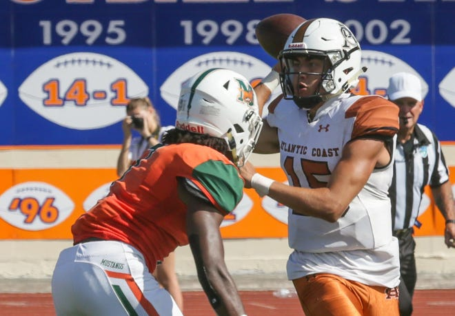 Atlantic Coast quarterback Ridge Jacobs (15) releases a pass as Mandarin linebacker Nic Mitchell closes in during the 2019 Bold City Showcase. Jacobs committed to Holy Cross. [Will Brown/St. Augustine Record]
