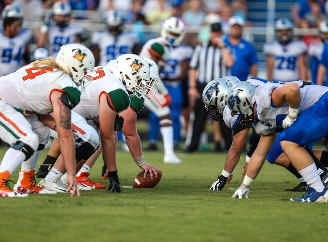 Mandarin and Bartram Trail players face off at the line of scrimmage in the teams' 2019 meeting.