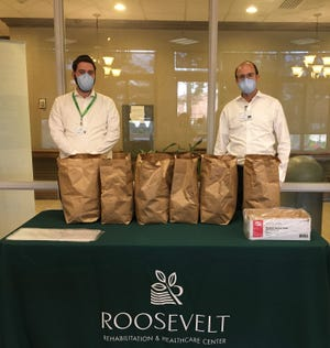 Staff members at the Roosevelt Rehabilitation and Nursing in Northeast Philadelphia accepted breakfast treats compliments of TruMark Financial Credit Union to recognize health care professionals caring for patients.