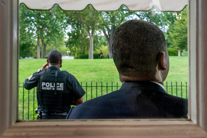 Members of the U.S. Secret Service stand guard outside the James Brady Press Briefing Room on Monday as President Donald Trump held a news conference at the White House,. Trump briefly left because of a security incident outside the fence of the White House.