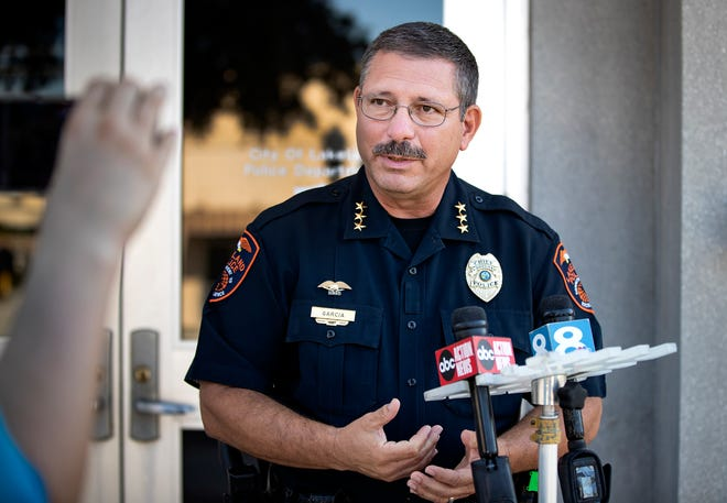 Lakeland Police Chief Ruben Garcia answers questions during a news conference at the police department Tuesday. Police are investigating a crash that occurred when a man fleeing in an alleged stolen car had a near head-on collision with a 19-year-old woman driving with her infant in the car. [ERNST PETERS/THE LEDGER]