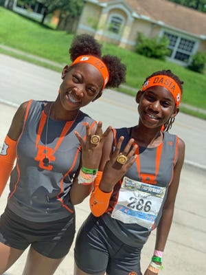 Dasia Reed, right, won the 100, 200 and 400 in the 11-year-old age group, and Zykierra Hightower finished seventh in the 100 and 200 in the 13-year-old age group last week in the AAU Junior Olympics. [PHOTO PROVIDED TO THE LEDGER]