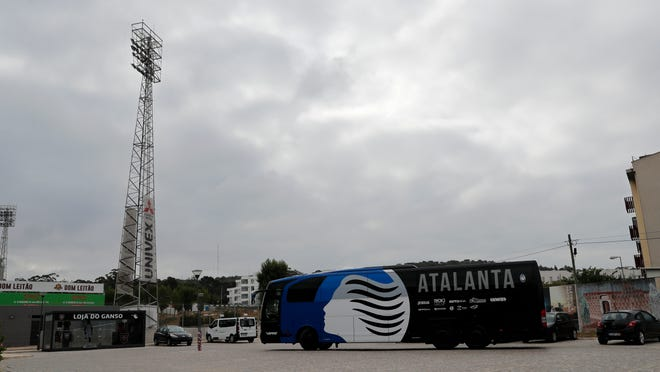 A bus carrying the Atalanta soccer team arrives at the Pina Manique stadium in Lisbon for a training session on Tuesday. Atalanta will face PSG in a Champions League quarterfinals match on Wednesday in Lisbon.