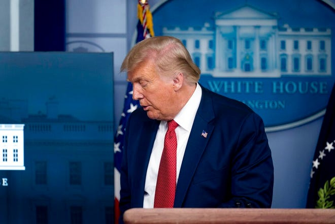 President Donald Trump leaves a news conference in the James Brady Press Briefing Room at the White House, Monday, Aug. 10, 2020, in Washington.  (AP Photo/Andrew Harnik)