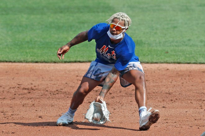 New York Mets starting pitcher Marcus Stroman fields a ground ball during a summer baseball training camp workout at CitiField last month in New York.