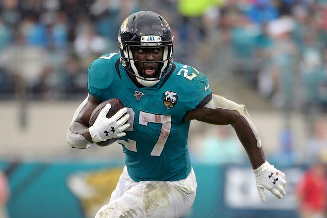Jacksonville Jaguars running back Leonard Fournette (27) rushes for yardage against the New York Jets during the first half of an October 2019 game in Jacksonville. Fournette used to be considered a building block in Jacksonville. Then he ended up on the trading block. Now, the bruising running back is entering the final year of his rookie contract and facing an uncertain future with the franchise.