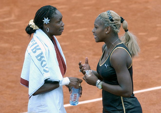 Serena Williams, right, talks with her sister Venus after Serena won the women's final of the French Open tennis tournament at Roland Garros stadium in Paris. in June 2002. Serena Williams advanced in the Top Seed Open to a second-round showdown against older sister Venus, who dispatched Victoria Azarenka 6-3, 6-2.