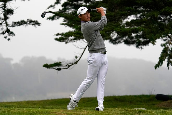 Collin Morikawa watches his tee shot on the 16th hole during the final round of the PGA Championship golf tournament at TPC Harding Park on  Sunday in San Francisco.