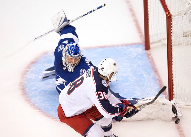 Tampa Bay Lightning goaltender Andrei Vasilevskiy (88) makes a save on Columbus Blue Jackets center Boone Jenner during the first period of an NHL Eastern Conference Stanley Cup first-round playoff game in Toronto on Tuesday.
