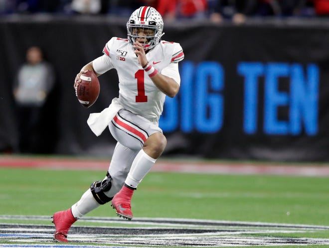 Ohio State quarterback Justin Fields runs with theagainst Wisconsin during the Big Ten championship game last season in Indianapolis. The Big Ten won't play football this fall because of concerns about COVID-19.