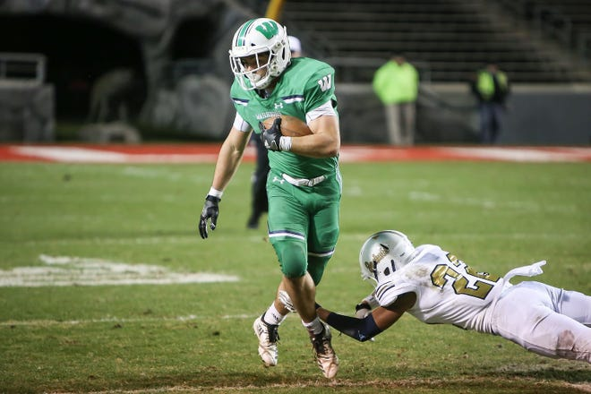 Weddington's Will Shipley breaks a tackle during the first half of the NCHSAA 3AA championship game on Saturday at Carter-Finley Stadium. Shipley finished with 256 yards rushing and four touchdowns.