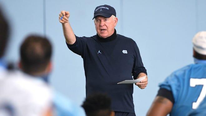 North Carolina coach Mack Brown directs a preseason football practice.