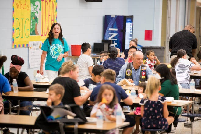 Students, parents and teachers have lunch and buy shirts during Northside Elementary School's orientation on Thursday, August 8, 2019.