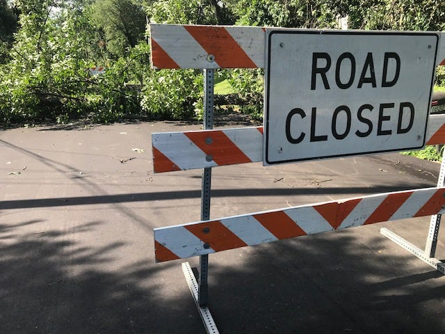 A tree was down Tuesday closing 10-Mile Road north of Michigan Avenue in Emmett Township.  Trace Christenson/The Enquirer