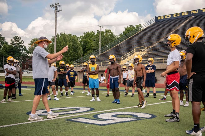 Battle Creek Central head varsity football coach Lorin Granger conducts the first practice of the season on Monday, Aug. 10, 2020 at Battle Creek Central High School.