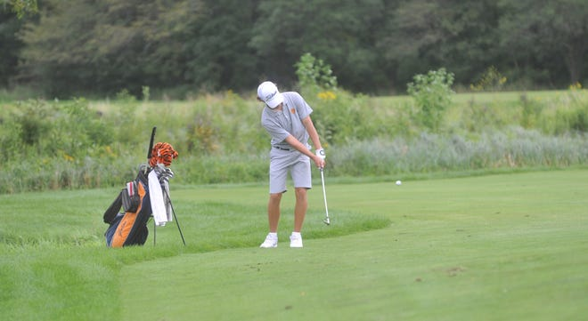 Galion's Spencer Keller chips onto the green of the 16th hole at NorthStar Golf Club in the Warrior-Jaguar Classic.