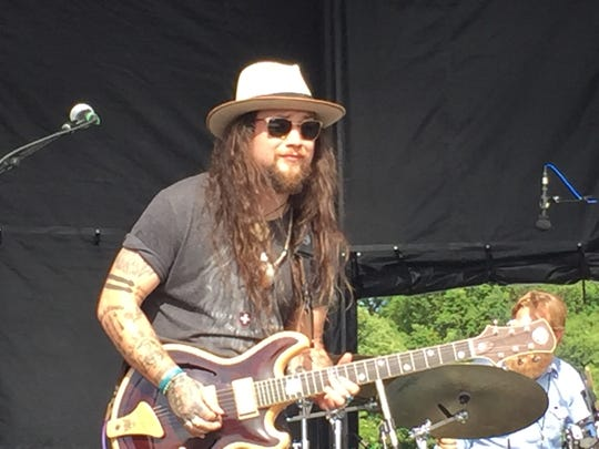 Twiddle front man Mihali Savoulidis, shown performing in 2017 at the Vermont-born jam band's Tumble Down festival in Burlington.