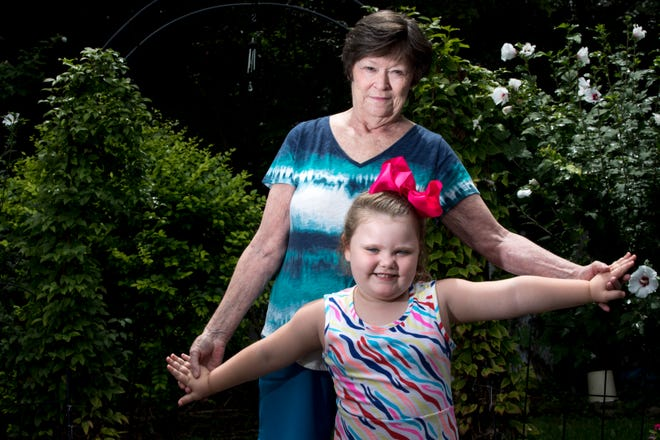 Mary Mahan, 71, stands with her great-granddaughter, Lyric, 4, who she is raising on Monday, Aug. 10, 2020, in Taylor Mill, Ky. Mahan is at high risk for COVID-19 because of both her age and having suffered from breast cancer twice. Due to her risk, she has opted to keep Lyric home from preschool for online schooling.
