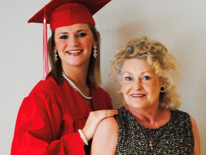 Candace Short poses with her grandmother, Beverly Krueger, in a graduation photo.
