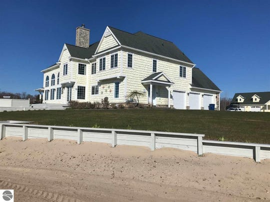 Located on St. George's point on Cedar Lake near Oscoda and the AuSable River, the home has 425 feet of lakefront and is over 6,000 sq.ft.  Amenities include a two-story Great Room, two-story stone fireplace, marble floors, and an 1800 sq.ft. detached garage with a lounge loft area.