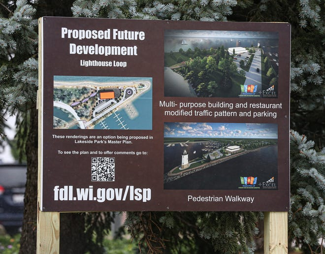 A sign showing proposed changes to Lakeside Park greets drivers as they drive onto the lighthouse peninsula in Lakeside Park in Fond du Lac.