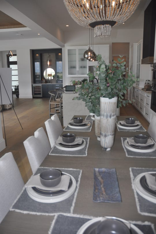 The dining room table that seats eight people opens up to the kitchen and living room area.