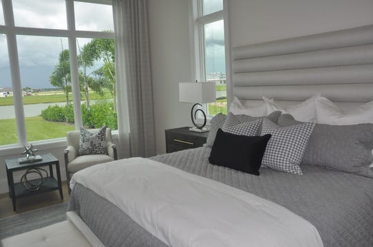 The master suite has a wall of windows plus a glass door that leads to the lanai.