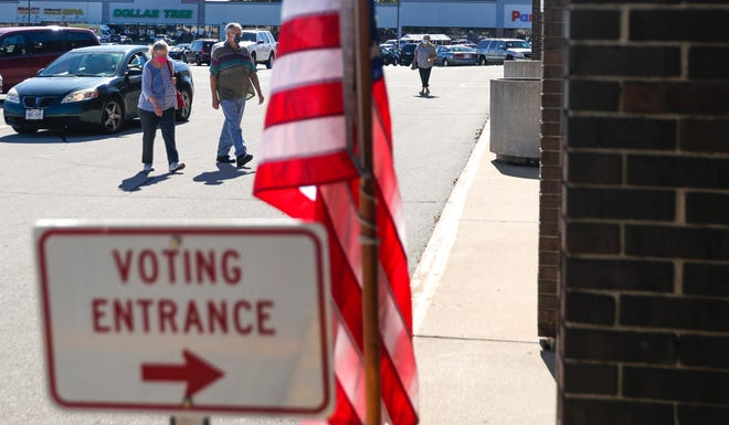 Voters enter the former Sears building to cast their vote in Wisconsin's partisan primary on Tuesday, Aug. 11, 2020, in the Green Bay Plaza shopping center in Green Bay, Wis.