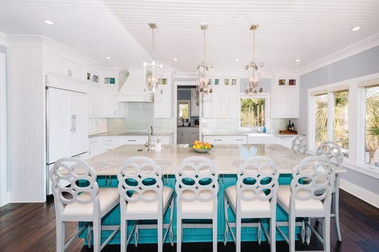 Coastal home kitchen that's roomy enough for large gatherings.