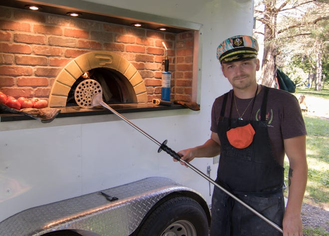 Nick Mannisto, shown  Tuesday, Aug. 11, 2020, has launched an unique food truck business, making wood fired pizzas.