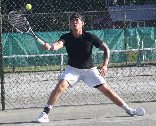 """Repeat men's singles champ Nicky Wong slides along the clay to make a forehand return in his 6-3, 6-3 victory over Alex """"Bones"""" McCann in the 87th News Journal/Richland Bank Tennis Tournament at Lakewood Racquet Club"""