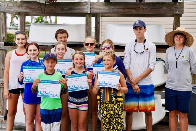 Marco Island young sailors proudly display their Certificates of Completion of 2020 summer sailing courses; 130 children completed the beginner and intermediate programs.