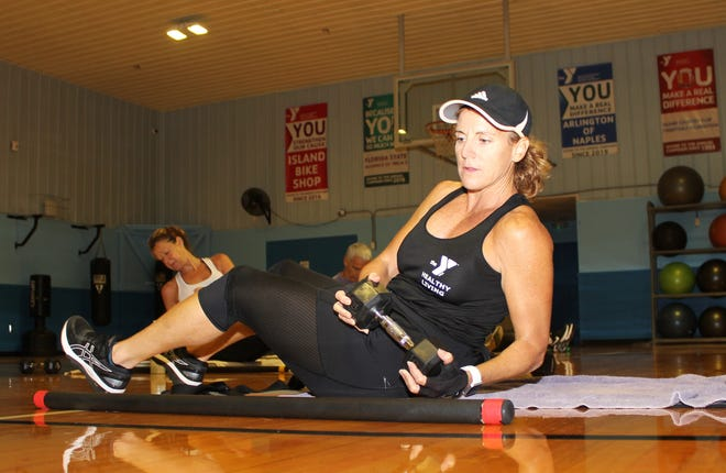 Stacy Witthoff leads an exercise using weights as resistance.