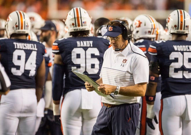 Auburn head coach Gus Malzahn looks at his play sheet on the sideline during a break in the action at Jordan-Hare Stadium in Auburn, Ala., on Saturday, Sept. 28, 2019. Auburn defeated Mississippi State 56-23.