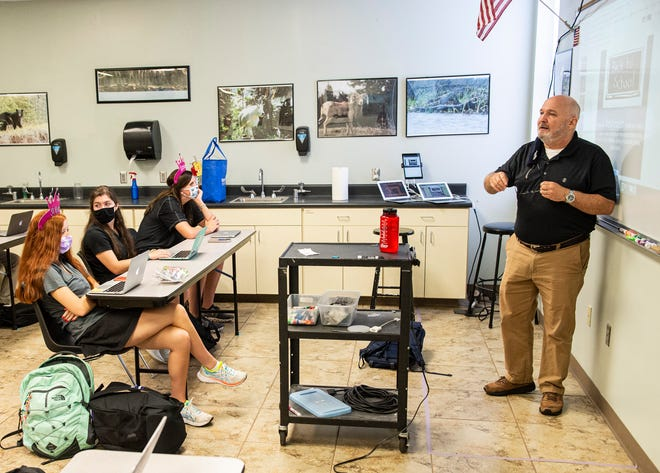 Upper School science teacher Jeff Bergdolt teaches his class during the first day of school at Prattville Christian Academy in Prattville, Ala., on Tuesday, Aug. 11, 2020. Bergdolt marked the floor with tape where he can teach from while maintaining social distance.