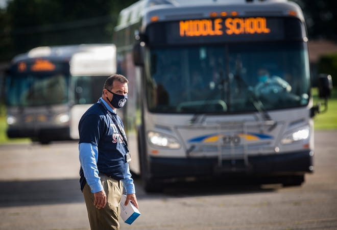 Principal Eric Grim watches students arrive on the first day of class at Northside Middle School in this file photo.