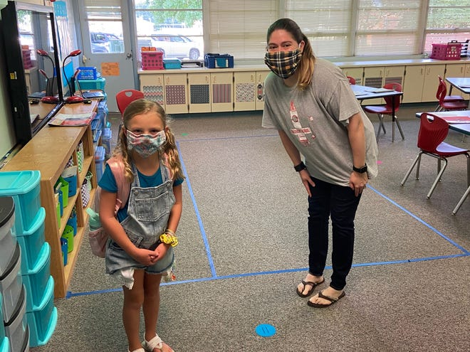 Student Elizabeth Gilliland poses with teacher Hannelore Dowell on Monday (Aug. 10, 2020), the first day of the year for Murfreesboro City Schools.