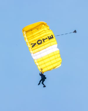 A member of the Women's Skydiving Network celebrates 100 years of the women's right to vote July 18 in Seneca Falls, New York. The demonstration, which included banners, flags and messages celebrating the 19th Amendment, was carried out by the network's Highlight Pro Skydiving Team.