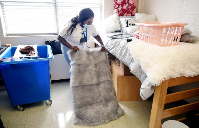TSU incoming freshman Tiffany McLilly of Humboldt, Tenn. decorates her dorm room on TSU's campus on Tuesday, August 11, 2020 in Nashville.