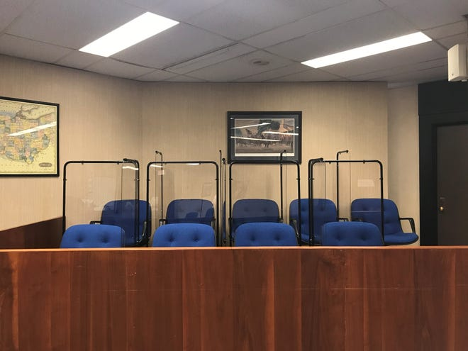 Plastic partitions appear between jurors' seats in the jury box inside Licking County Municipal Court Courtroom three.
