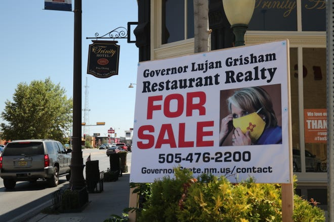 A sign is erected to protest Gov. Michelle Lujan Grisham's order that restaurants close indoor dining, Aug. 11, 2020 at the Trinity Hotel and Restaurant in Carlsbad.