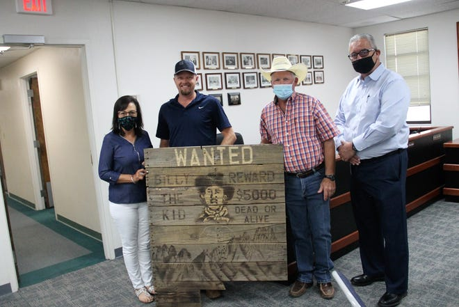 From left are Otero County Executive Assistant Sylvia Tillbrook, Otero County Project Manager Trent Parker, Otero County Commission Chairman Gerald Matherly and Otero County Prison Facility Warden Ricardo Martinez stand with an artwork made by an OCPF inmate August 10, 2020.