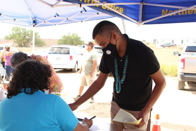 Zachariah George files his candidacy paperwork for the vice president seat for Whiterock Chapter on Aug. 10 in Window Rock, Arizona.
