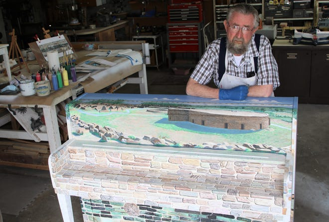 Artist Timithy Gordon poses behind his contribution to the Painted Pianos -- Big Sound in a Small Town project that will be unveiled this weekend in Aztec.