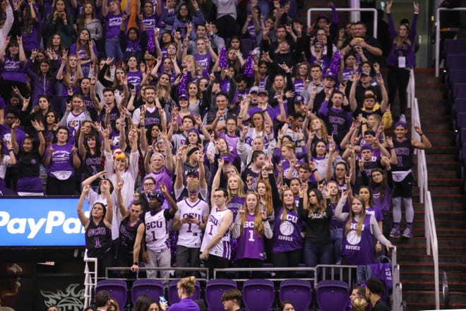 """The GCU Havocs hold up the """"lopes up"""" hand signal during their matchup against the Liberty Flames in the Air Force Reserve Jerry Colangelo Classic on Dec. 8, 2019, at Talking Stick Resort Arena in Phoenix."""
