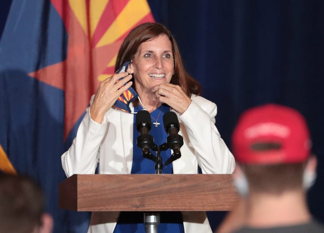 """Sen. Martha McSally, R-Ariz., removes her mask before speaking ahead of Vice President Mike Pence's """"Latter-day Saints for Trump"""" campaign event in Mesa on Aug. 11, 2020. It was his second stop in the battleground state after visiting Tucson earlier in the day."""